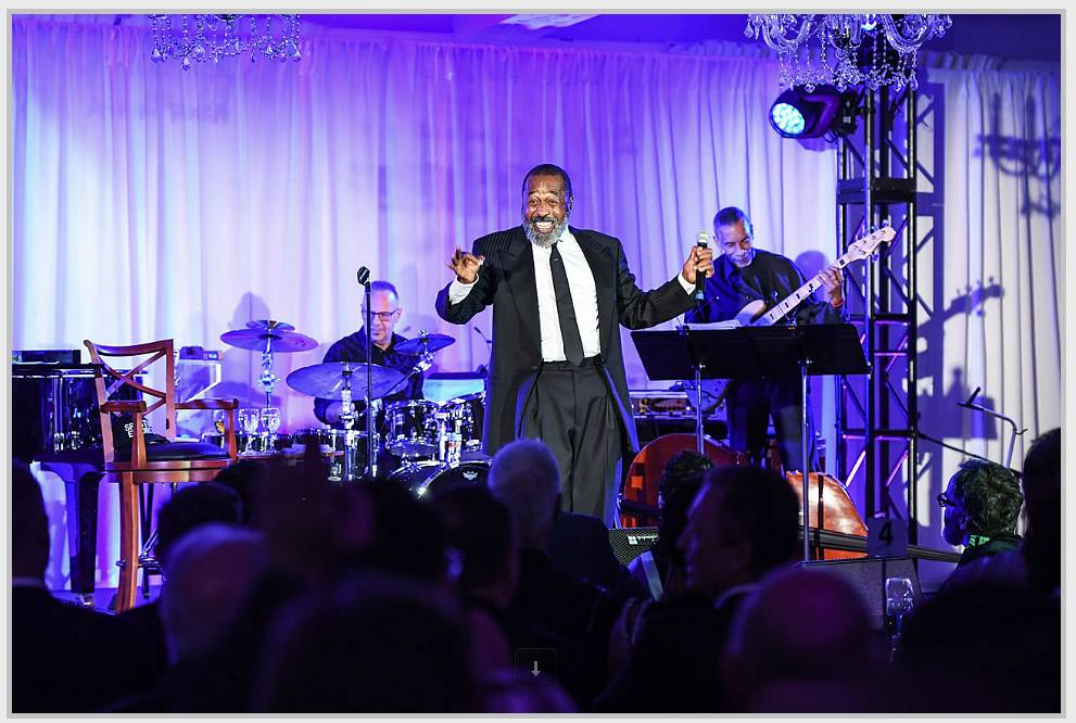 Ben Vereen performing on stage in front of an audience at The 519 Annual Gala 2018