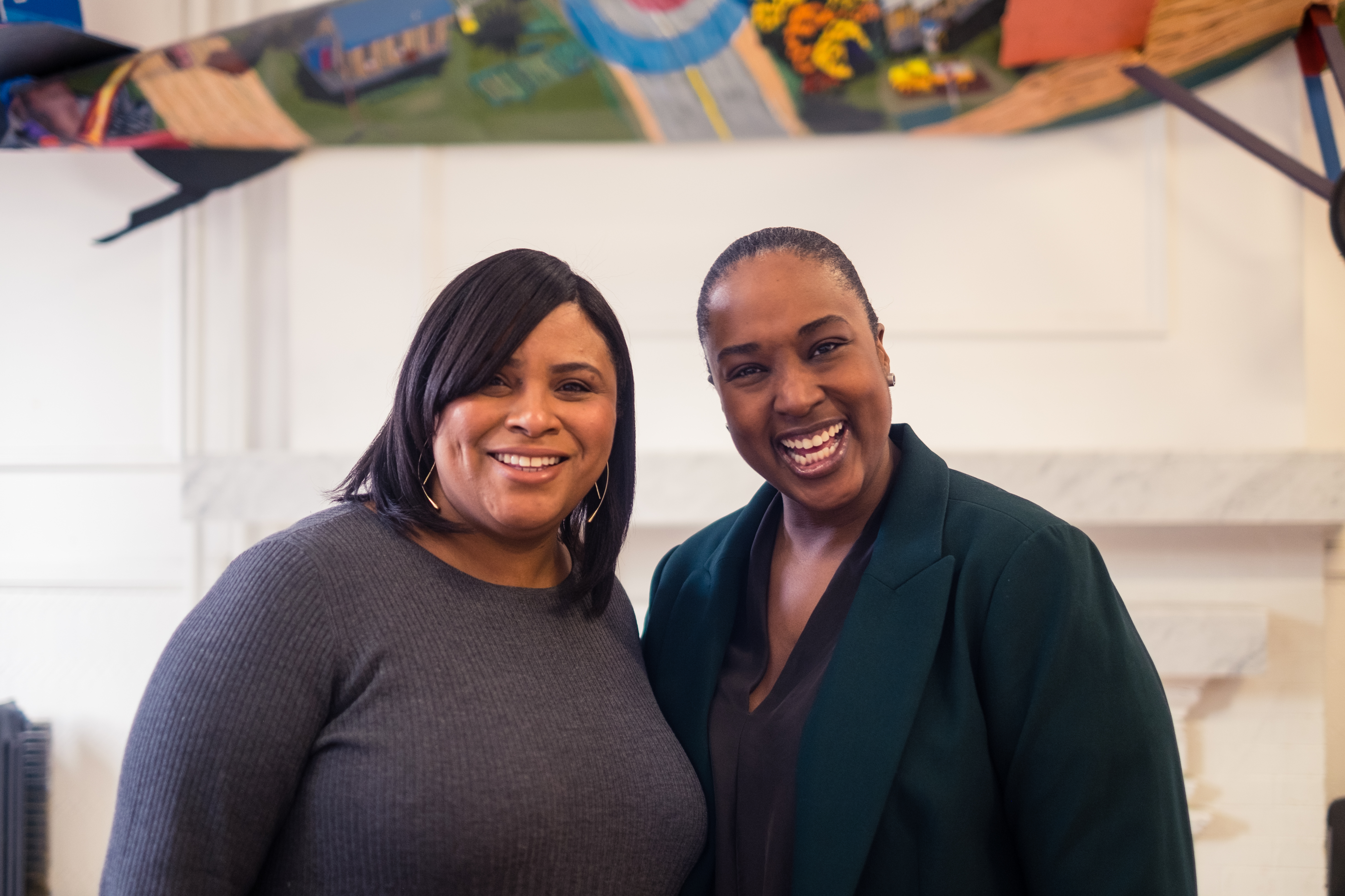 Jill Andrew and Aisha Fairclough portrait. Both of them smiling.
